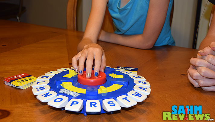 Tapple by USAopoly is a fast-paced word game suited for all ages. With categories for adults and kids, it is sure to keep everyone entertained during your next family game night! - SahmReviews.com