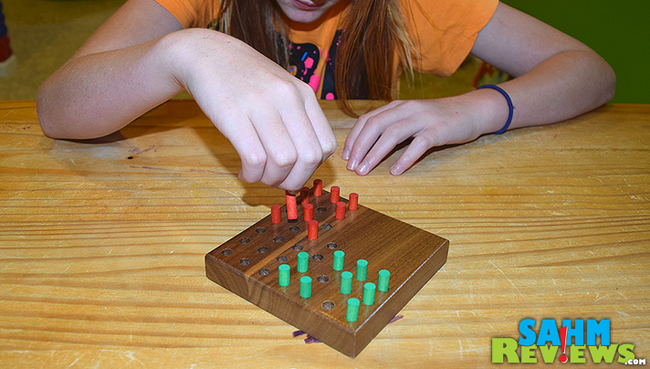 Like a 2-player version of Chinese Checkers, the Turn About Peg Puzzle is a quick 2-person game. - SahmReviews.com