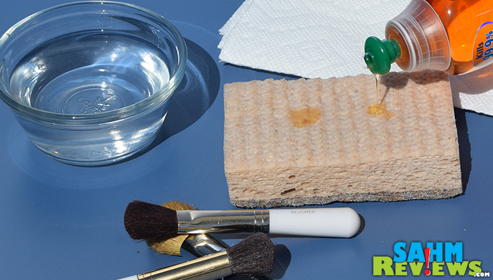 Clean your makeup brushes. Step 1 - Add Palmolive to a sponge. - SahmReviews.com #PalmoliveWM