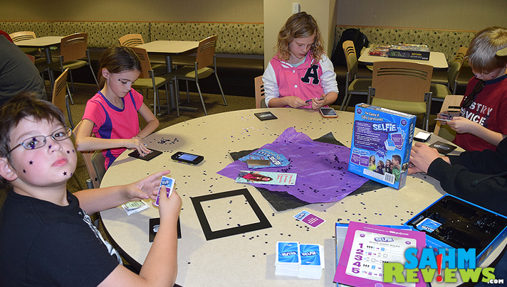 Take a selfie, show it to your opponents, pick your favorite and collect the win! Selfie from USAopoly turns the camera fad into a party game for all ages! - SahmReviews.com