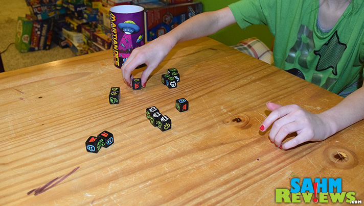 Available for under $8 on Amazon, Martian Dice by Tasty Minstrel Games is a perfect time-killer for all ages. And you get to abduct people! - SahmReviews.com