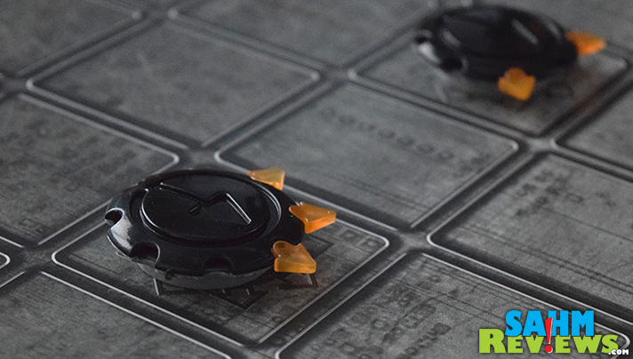 """By today's standards, checkers is boring. What if you could """"program"""" your pieces to move in different directions? Octi from FoxMind Games does just that! - SahmReviews.com"""