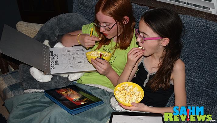 Sibling bonding while watching Paddington movie. - SahmReviews.com #PaddingtonMovie