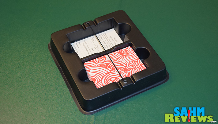 This week's Thrift Treasure isn't a game, but a new tool for any standard card game. Using a special board and cards, play outside without the fear of wind! - SahmReviews.com