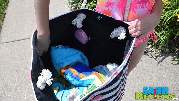 A beach towel, glasses, a change of clothes and a cute tote. Ready for the pool! - SahmReviews.com #PaylessInsider #SoleStyle
