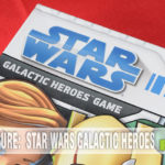 If you're awaiting the release of Star Wars: Episode VII - The Force Awakens, bide your time with a battle or two in Milton Bradley's Galactic Heroes game. - SahmReviews.com