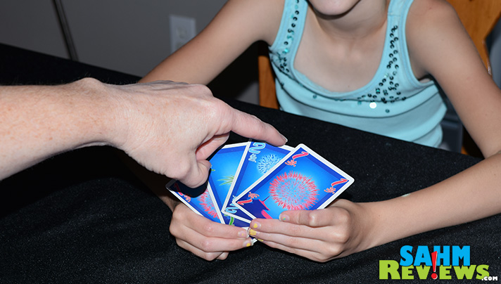 Fireworks building in Hanabi was our other 4th of July board game choice. This cooperative title from R&R Games is a favorite any time of the year! - SahmReviews.com