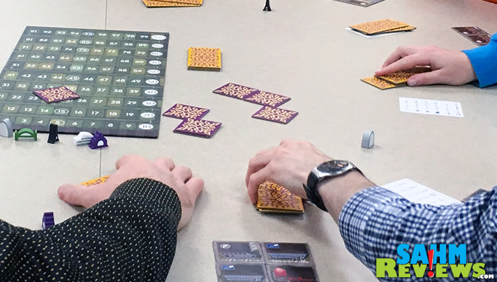 Select tiles to add to your cities in Between Two Cities. - SahmReviews.com