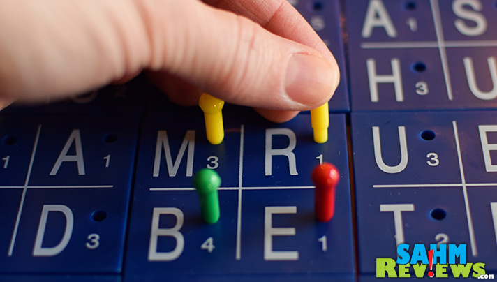 Colored pegs are added to the Keesdrow word seek board to indicate how many times a letter has been used. Three is the limit so use them wisely. - SahmReviews.com