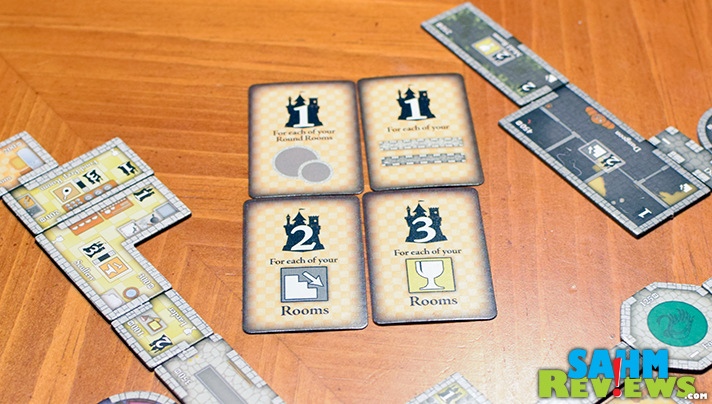 Bonus cards in Castles of Mad King Ludwig provide every player with different end-game goals. - SahmReviews.com