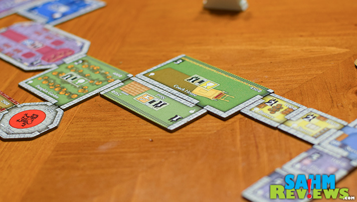 With Castles of Mad King Ludwig, players work to build the best castle. - SahmReviews.com