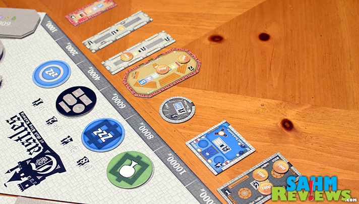 The Master Builder of Castles of Mad King Ludwig can really mess with their opponents by rearranging rooms on the contract board! - SahmReviews.com
