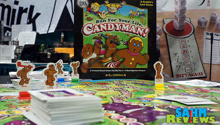 Take revenge on that classic gumdrop game, Candyland, by biting the head and arms of your opponent in Run For Your Life, Candyman! by Smirk & Dagger Games! - SahmReviews.com