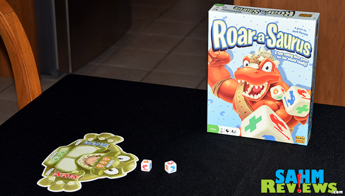What's better than a game about dinosaurs? A game with battling dinosaurs! We take Roar-a-Saurus for a roll - and lose again... - SahmReviews.com