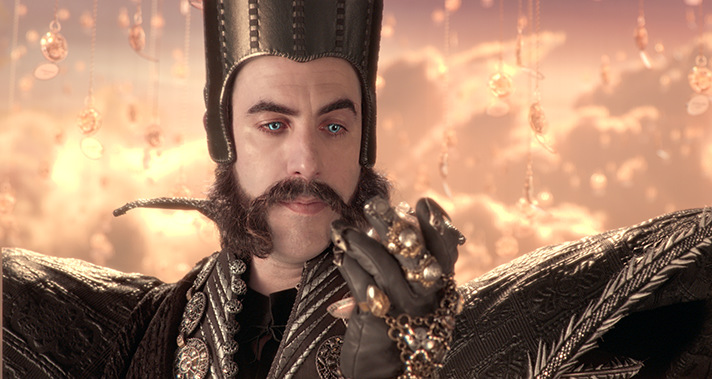 Sacha Baron Cohen plays Time in Alice Through the Looking Glass. - SahmReviews.com