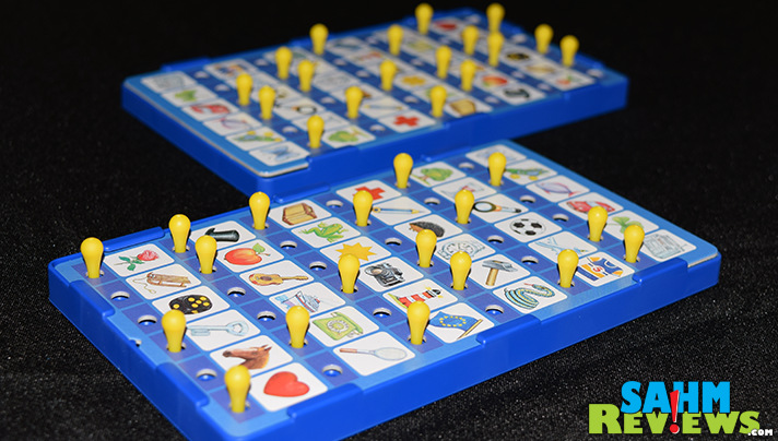 We were dumbfounded when we found a game without instructions and in a completely different language! Did we ever find out how to play Łowca Obrazków? - SahmReviews.com