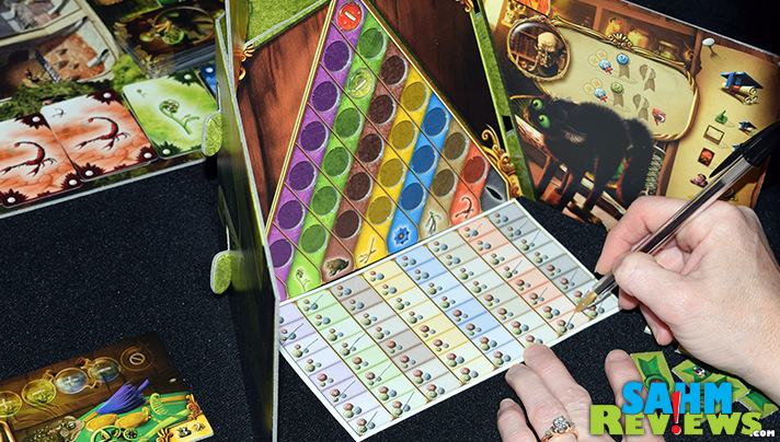 In Alchemists game, combine various ingredients and test them out to deduce their components. - SahmReviews.com