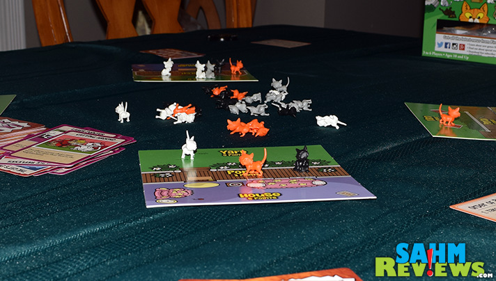 So many cats and they all need homes. Here Kitty Kitty by Fireside Games has neighbors vying to lure the cats in. - SahmReviews.com