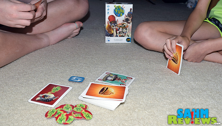 Cats like to eat but can they avoid the indigestion? Tem Purr A by iello Games has them trying. - SahmReviews.com