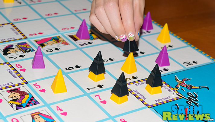 Touché is a mix of Sequence and Tic-Tac-Toe. Find out why we were excited to add this abstract game by Cadaco to our collection! - SahmReviews.com