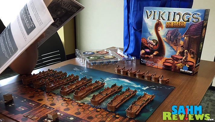Vikings on Board from Blue Orange Games has players vying to take control of the ships and the supplies before they set sail. - SahmReviews.com