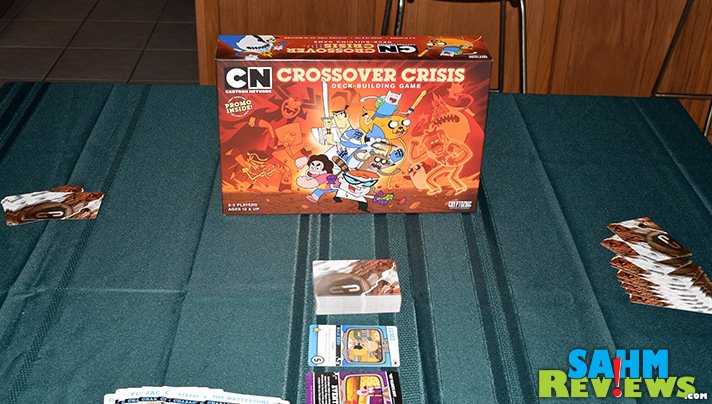 Saturday morning cartoons were a treat in the 70's, now there's on 24-7. Crossover Crisis by Cryptozoic Entertainment brings today's cartoons home! - SahmReviews.com