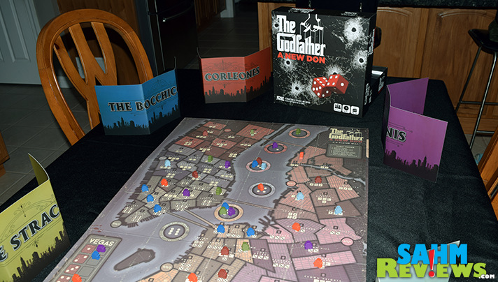 Take bribes, offer favors, flex muscle and more to take control of boroughs in The Godfather A New Don board game. - SahmReviews.com
