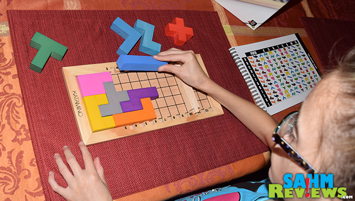 Most puzzles are designed for one player. Katamino by Gigamic puts a little extra in the box with a two-player challenge version! - SahmReviews.com