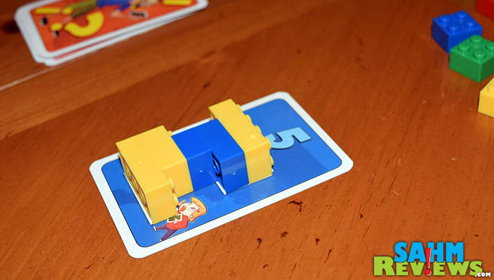 Take classic tangrams and combine it with your old Legos and you get this new game by Renegade Game Studios. See if you can build faster in Brick Party! - SahmReviews.com