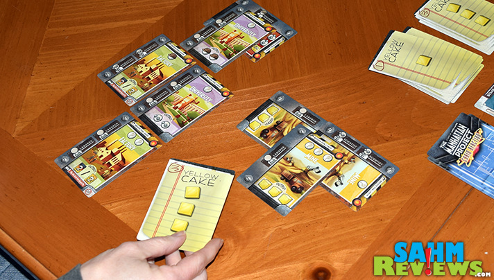 While we wait for the expansion to Manhattan Project, we had a chance to play Minion Games' Manhattan Project: Chain Reaction. What did we think of it? - SahmReviews.com