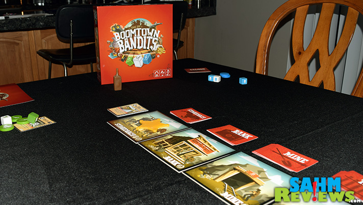 The wild west is out of control as bandits rob the bank, mine, train and more! Quick hands and luck are needed to win Boomtown Bandits by Breaking Games. - SahmReviews.com