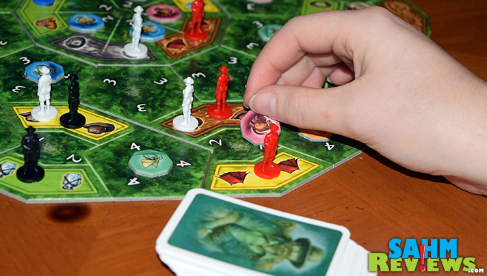 Coordinate resources in an attempt to capture extinct creatures in La Isla by Ravensburger. - SahmReviews.com