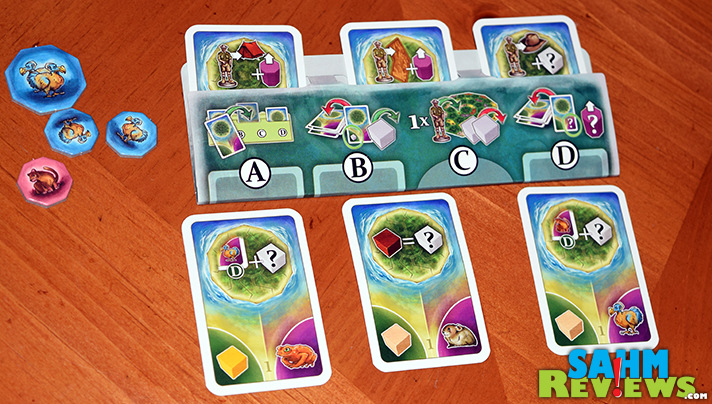 Use your cards wisely to gather resources in an attempt to capture extinct creatures in La Isla by Ravensburger. - SahmReviews.com