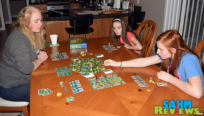 Coordinate resources in an attempt to capture extinct creatures in La Isla by Ravensburger. The modular board and setup make each game different. - SahmReviews.com