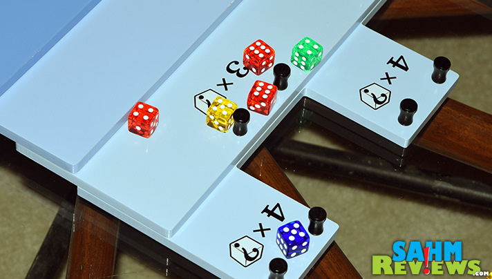 Tumblin' Dice by Eagle-Gryphon Games takes curling to another level. Literally. Add dice and a 3-D playing area and you've got an instant classic! - SahmReviews.com