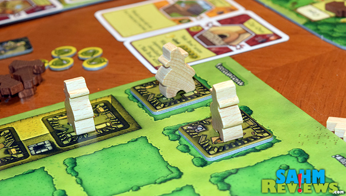 Players are working to create the best farm in Agricola by Mayfair Games. - SahmReviews.com
