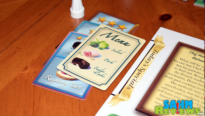 In Calliope Games' Titan series board game, Menu Masters, chefs purchase ingredients to complete personal or community menus. - SahmReviews.com