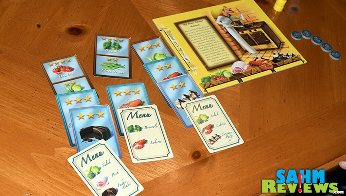 In Calliope Games' Titan series board game, Menu Masters, up to five chefs purchase ingredients in an effort to craft the best menu for their restaurant. - SahmReviews.com