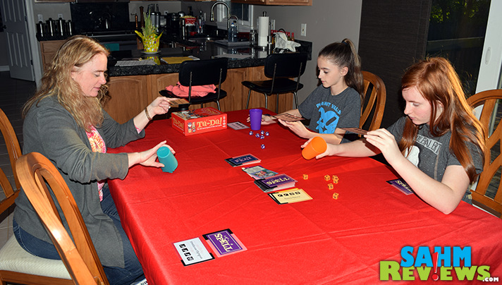 In Ta-Da! dice game from Cool Mini or Not, players race to be the first to meet their designated requirements. - SahmReviews.com
