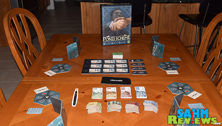 Most economic games teach you how to build wealth. Ponzi Scheme by Tasty Minstrel Games does the opposite! Just try not to go bankrupt! - SahmReviews.com