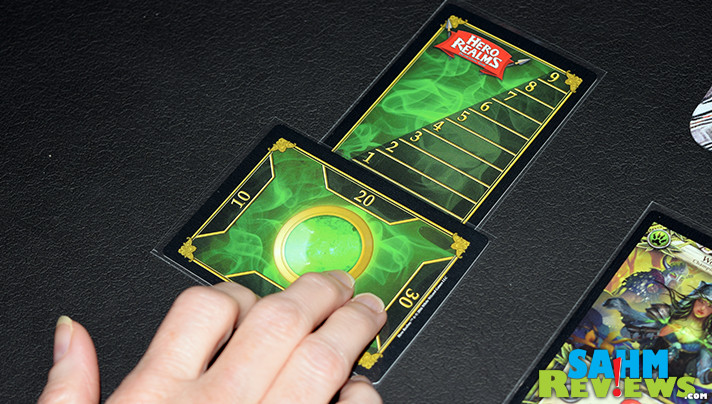 We hated the thought of always buying packs of cards to keep us competitive in a game. Hero Realms by White Wizard Games has that solved! - SahmReviews.com