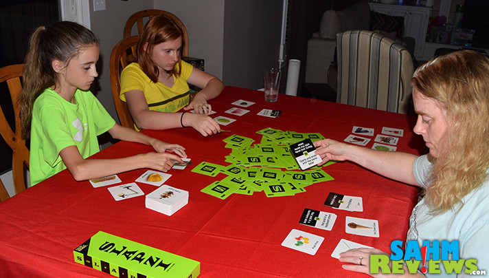 How to play SLAPZI, a new fast-paced and simple family card game from the people that created TENZI dice game. - SahmReviews.com