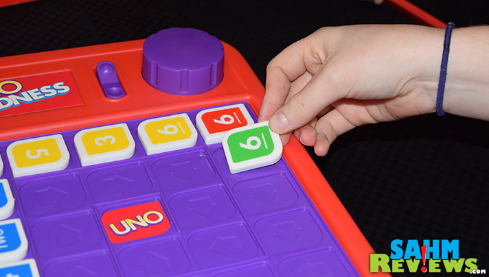 It's yet another version of UNO! Mattel's UNO Madness exchanges cards for tiles and adds a timer that penalizes you if it goes off on your turn. Find out more at SahmReviews.com!