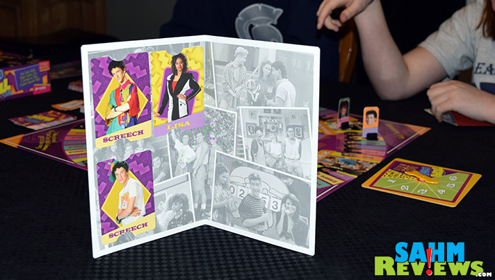 It's a flashback to the 90's with Pressman's Saved by the Bell Game. Test your memory and relive your crush on Kelly Kopowski with this brand new game! - SahmReviews.com