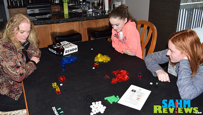 We were amazed by the simplicity and difficulty of this new logic game by Looney Labs. Zendo has won a permanent spot in our game collection! - SahmReviews.com
