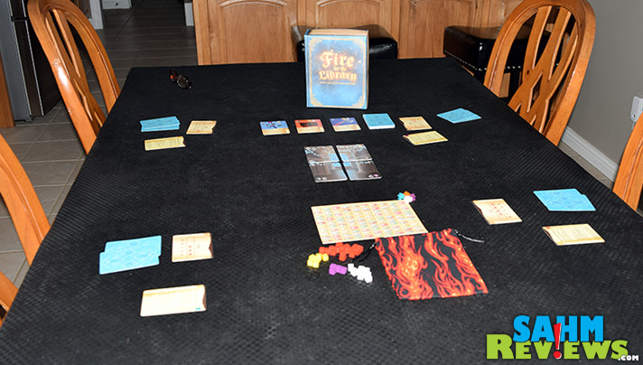 Try to save the books before they burn in Fire in the Library, a press-your-luck game from Weird Giraffe Games. - SahmReviews.com