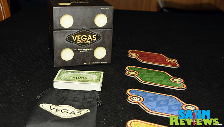 You don't have to fly to Vegas to elbow you way onto a table. Ravensburger's Vegas Dice fills that dice-rolling urge and introduces players to a new type of game! - SahmReviews.com