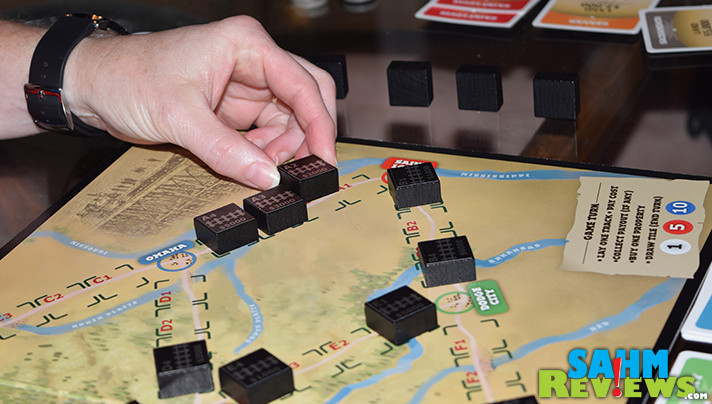 It won't take all afternoon to get a game of The Last Spike in - unusual for railroad-themed games. Read more to find out if it belongs in your collection! - SahmReviews.com