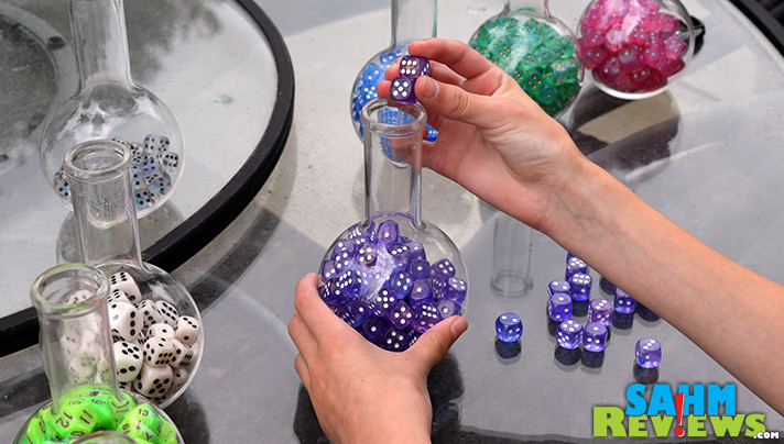 We've now amassed a sizable dice collection, but didn't have a way to display them. These lab flasks we found at Michael's turned out perfectly! - SahmReviews.com