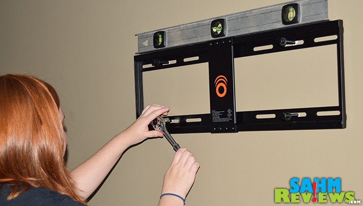 Large televisions like the VIZIO P65-F1 are ightweight enough to mount to the wall. Here's a tutorial on how to mount your television. - SahmReviews.com